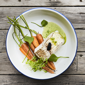 Sea wolf with baby carrots and seaweed caviar